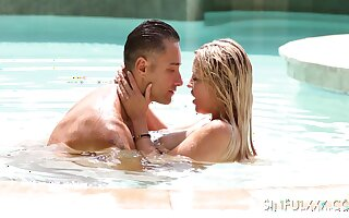 Solo married couple is making love in the pool