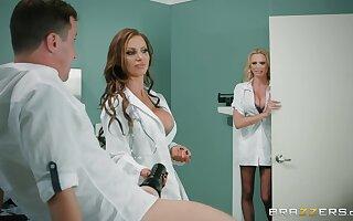 Premium nurses are enjoying a pretty big dick upon a hot threesome