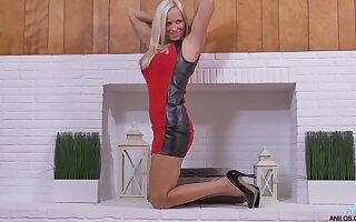 Desirable blonde model Dani Dare takes off her dress to masturbate