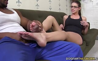 Laughing slutty nerdy nympho Brooklyn Chase fingers herself as she gives footjob