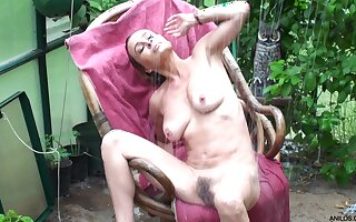Small boobs Amanda Hills moans while playing nearly the garden
