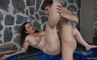 Pudgy brunette amateur Iveta has some fun in the whirlpool