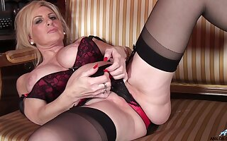 Cute mature Alexia Blue in stockings and high heels having some