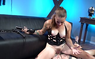 Subordinate jerks off in the long run b for a long time babe in corset sits on the exposure