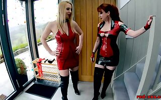 Red XXX and Lucy have fun in their latex outfits