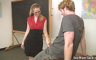 Quicke blowjob in the classroom with a mature blonde teacher