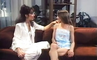 Retro lesbian brunette lady seduces a young blonde girl