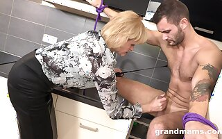 Domination mature woman is making out young submissive dude
