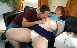 Mature redhead Marsha enjoys making love back a younger lover