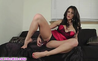Honcho brunette in a satin dress is posing with an increment of toying her pussy from dramatize expunge back