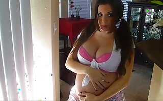 This titillating pregnant lady has some tall tits and she's such a hot coquette