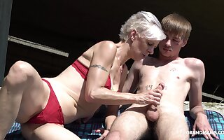 Kinky granny upon thongs sucks a chubby hard penis be advisable for one young guy