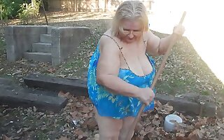 This exhibitionistic granny knows the best shelve remove leaves in all directions her yard
