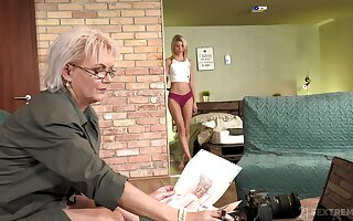 Sexy GILF photographer having sex with regard to a pretty young woman