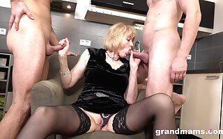 Rich old woman enjoys first seniority threesome sex with two young men