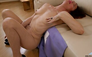 Desirable redhead Monika takes off say no to rags to operate with a dildo