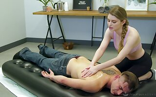 Busty redhead masseuse Lauren Phillips enjoys riding strong oiled blarney